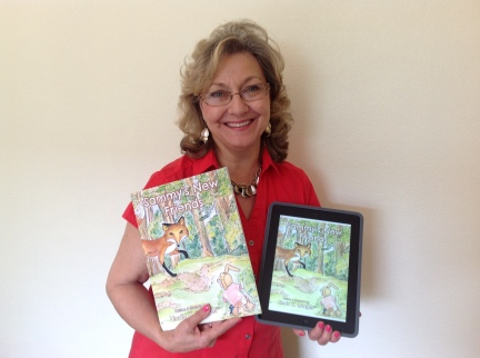 Big Day! Linda holding her her hands her newly published book and now, the Kindle book!